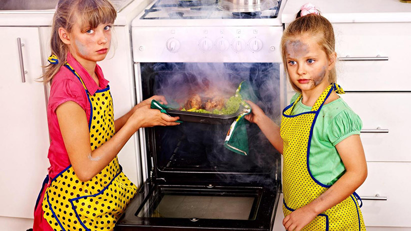 two little girls cooking